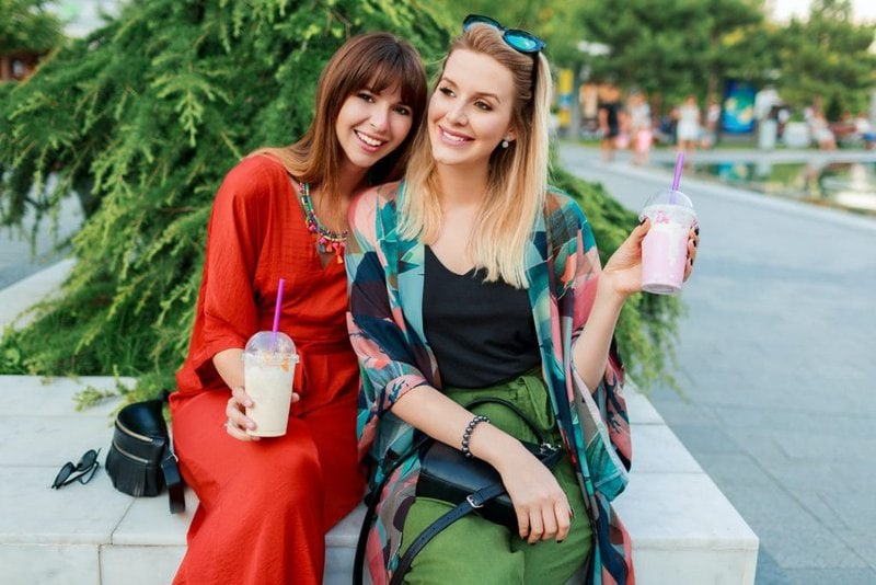 Two smiling woman.